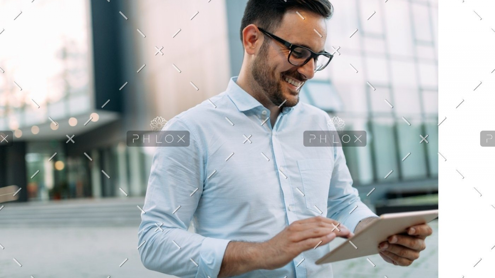 demo-attachment-815-portrait-of-businessman-in-glasses-holding-tablet-AWVHCJU